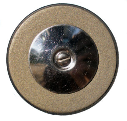 Photo of a black gold sax pad